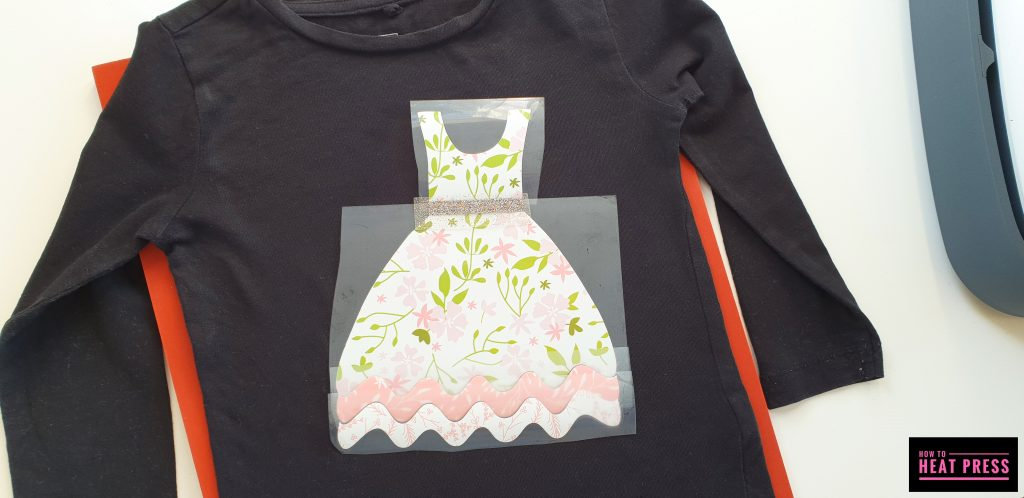 arrange patterned iron on design on t shirt