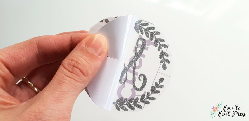 remove backing paper to apply vinyl to the curved surface