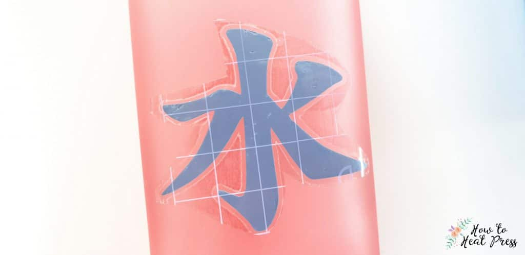 remove backing paper from design on glass bottle