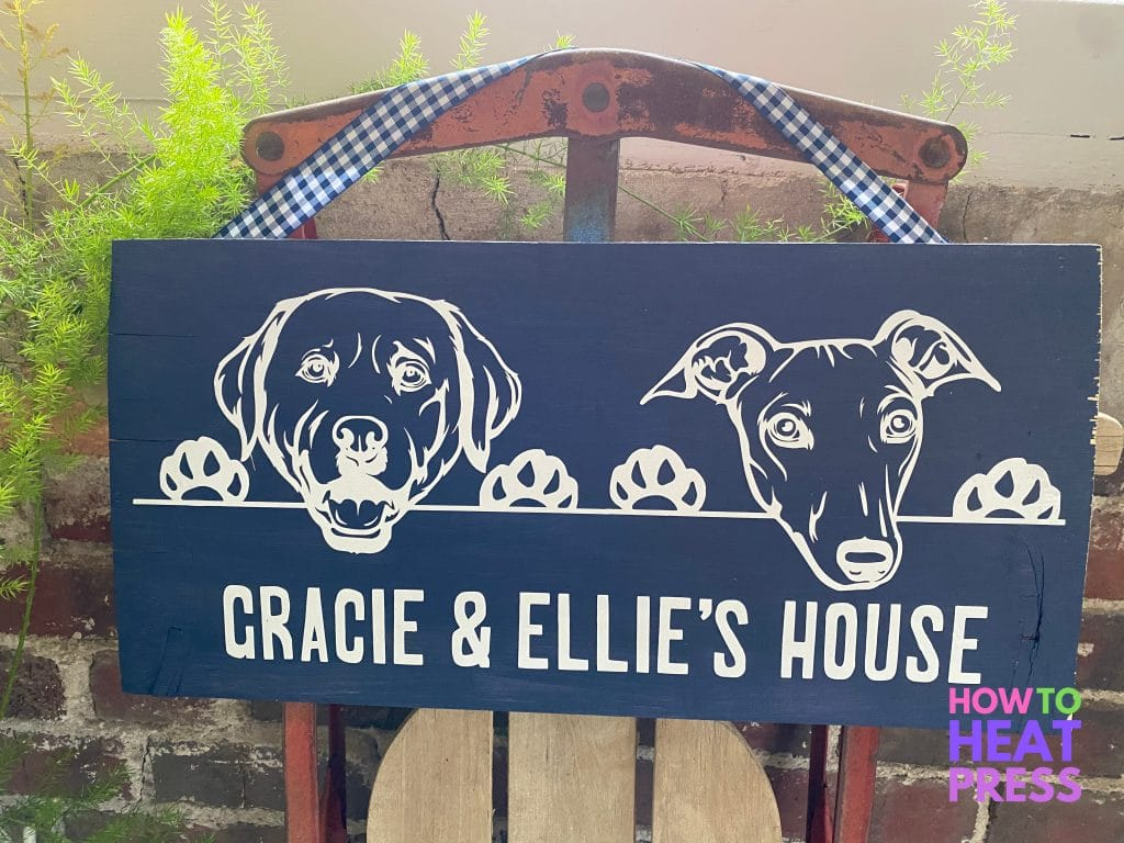 blue wood sign featuring white dogs