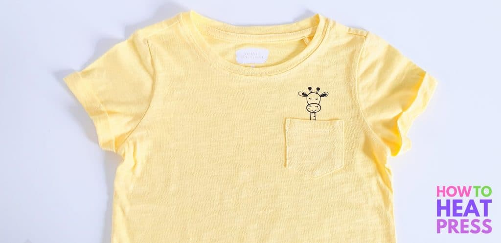 yellow shirt with giraffe looking out of pocket