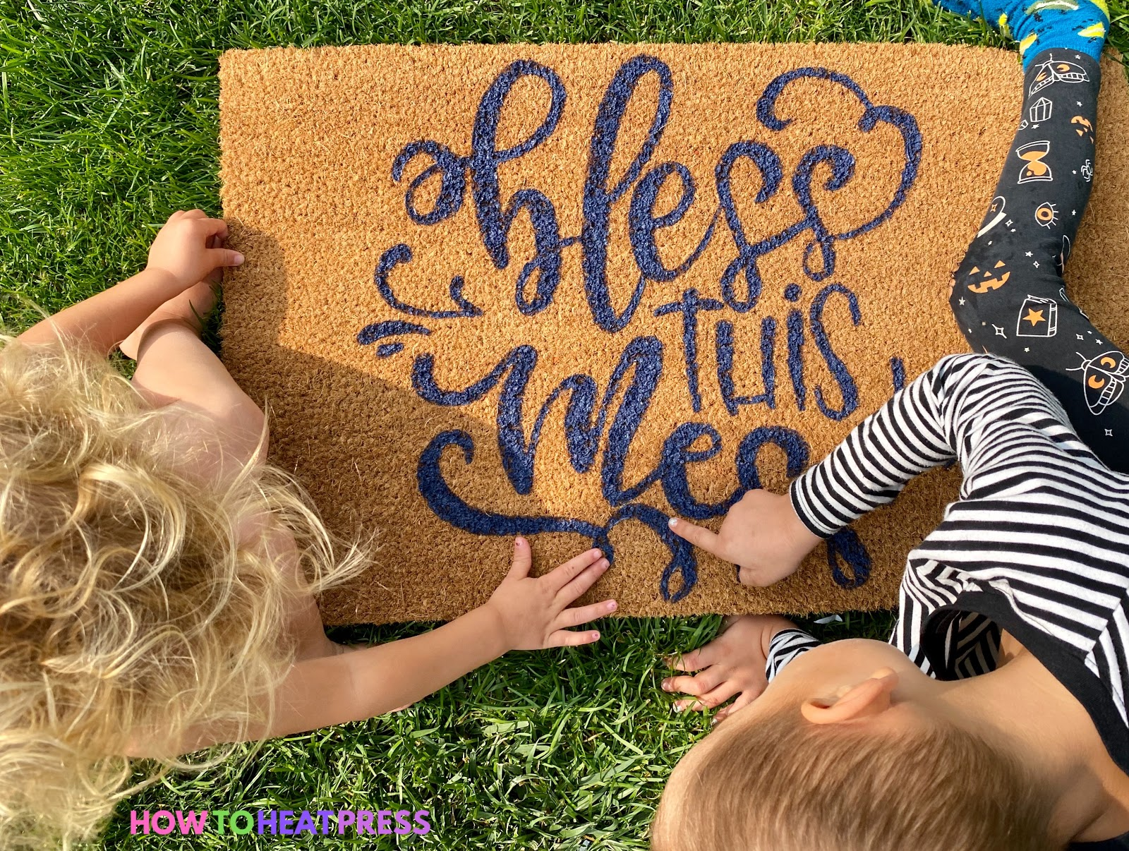 Tan DIY doormat with blue writing