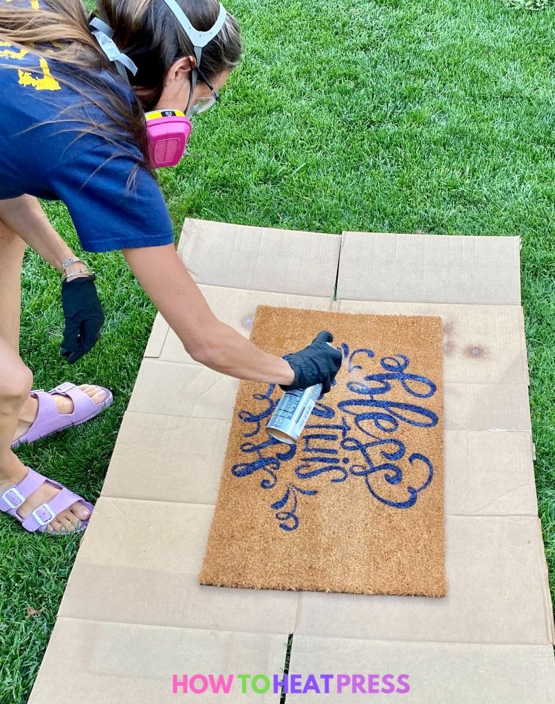 spraying flexseal on diy painted doormat