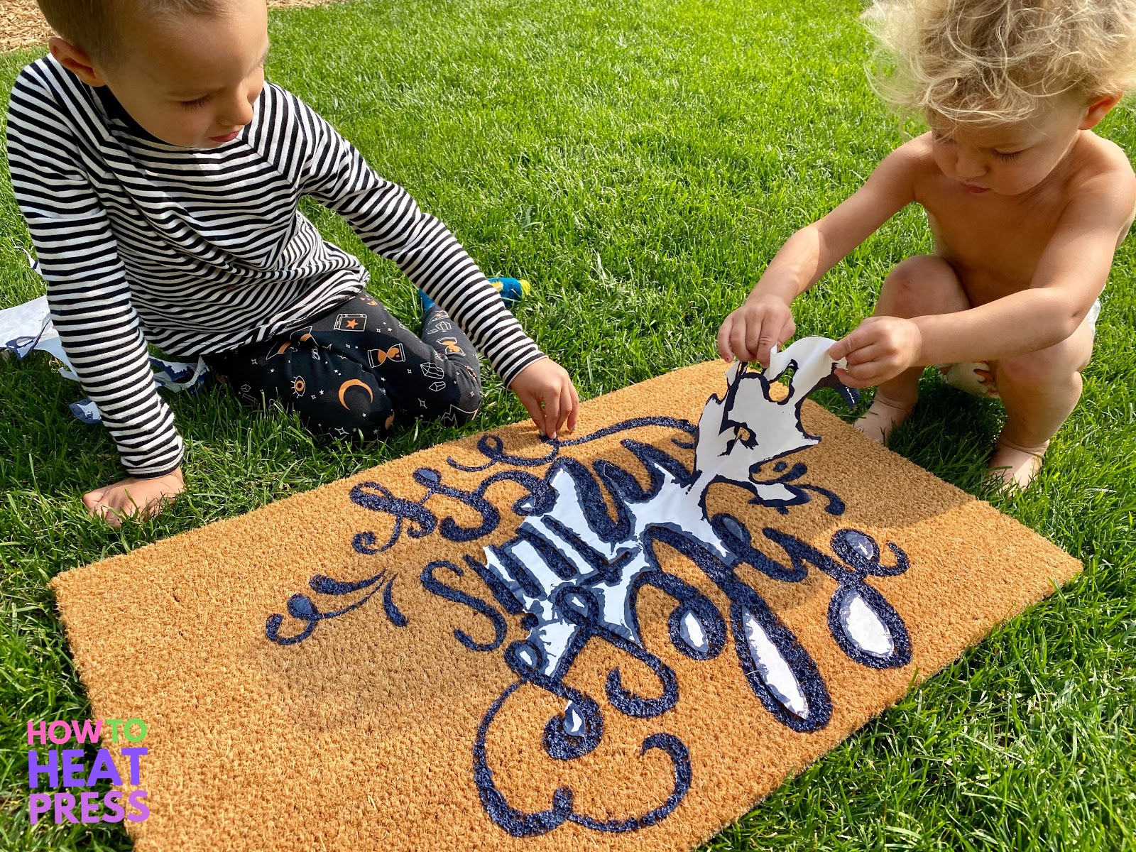 children peeling freezer paper stencil on diy doormat