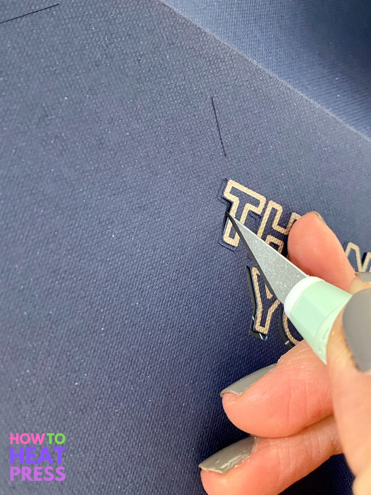 precision blade xacto knife removing cutouts on blue paper