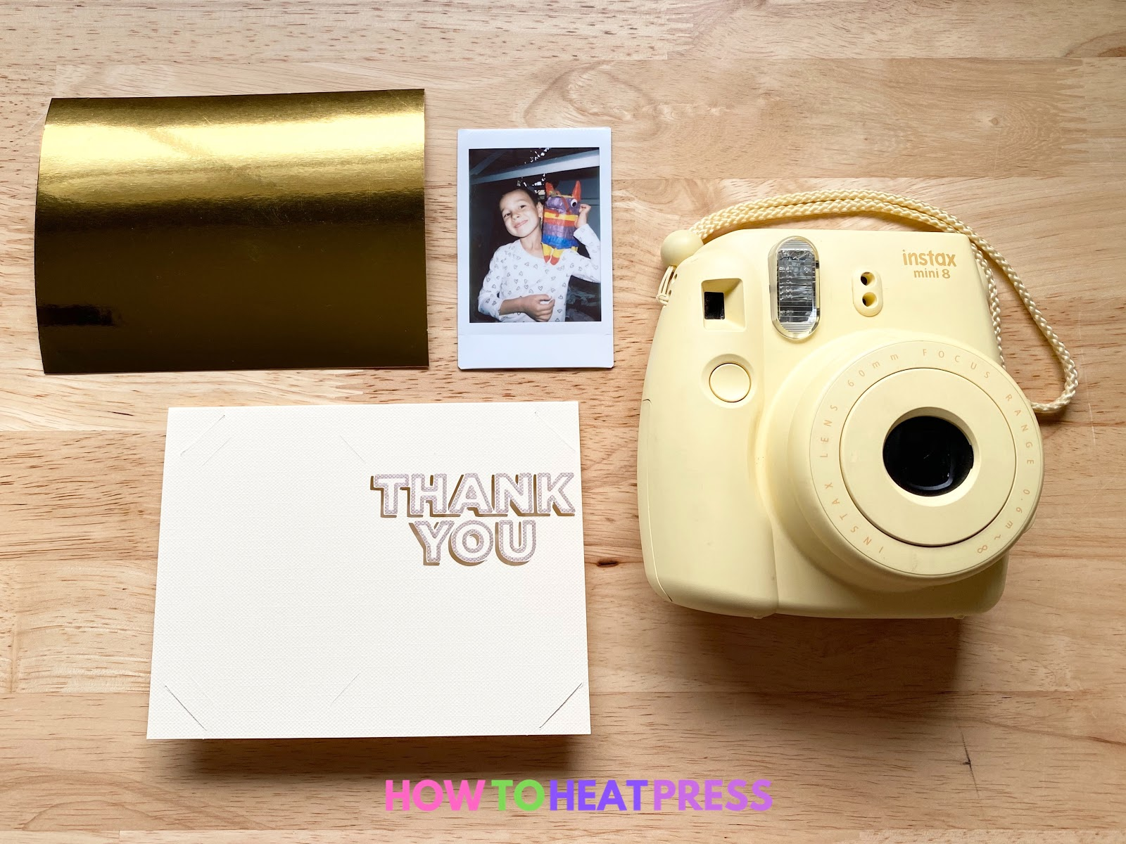 yellow fujifilm instax camera and photo with cream and gold diy thank you card
