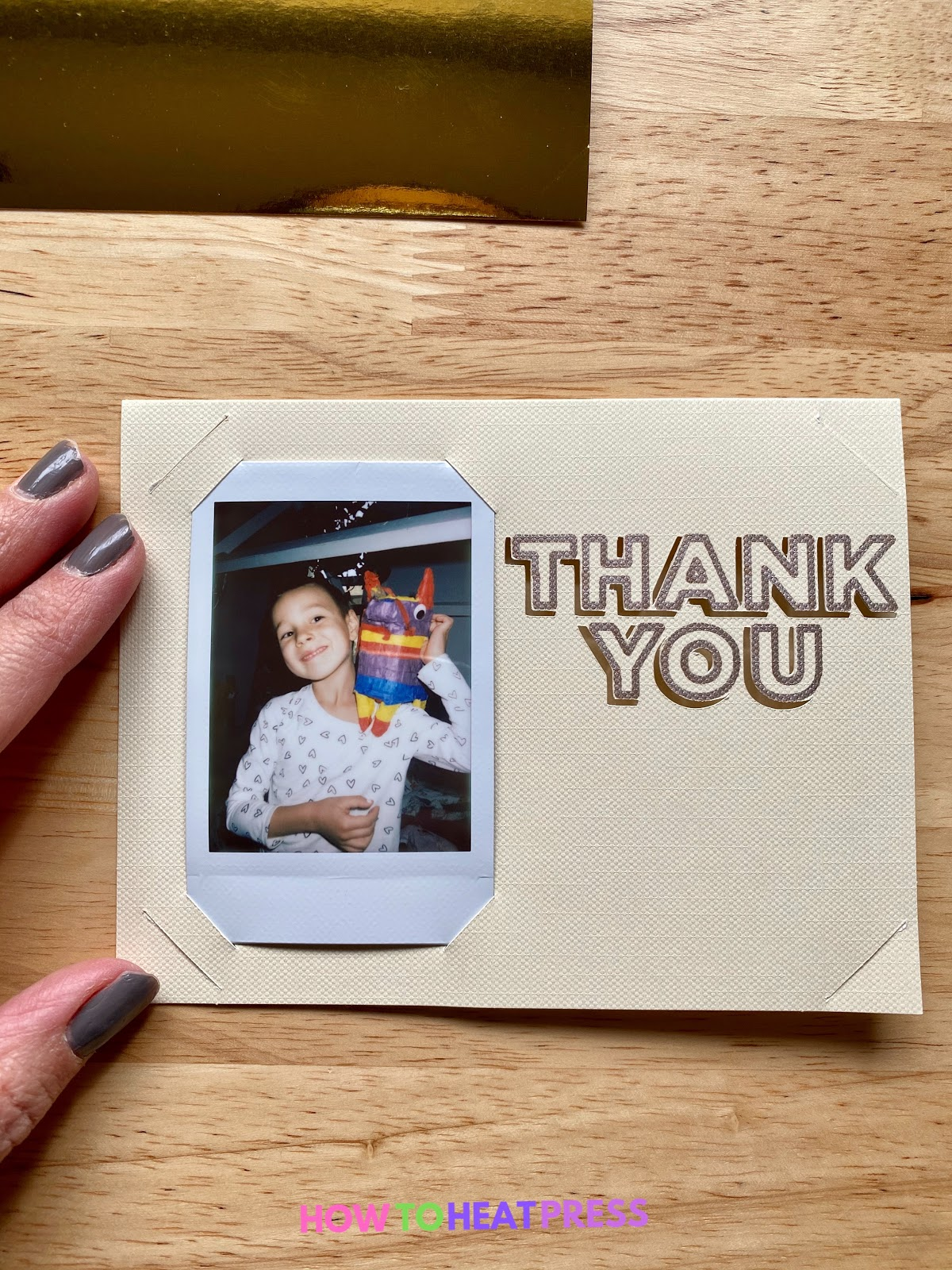 polaroid inserted into cream colored diy thank you card