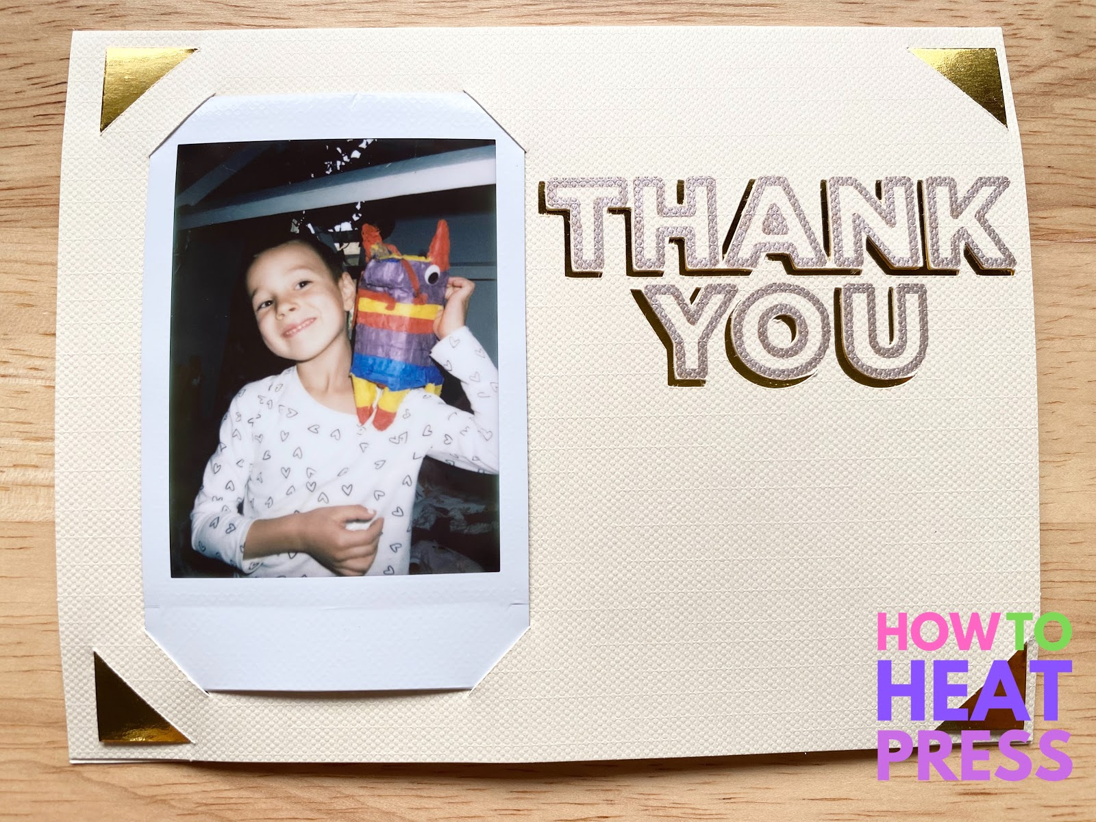 beige thank you note with polaroid photo and gold accents