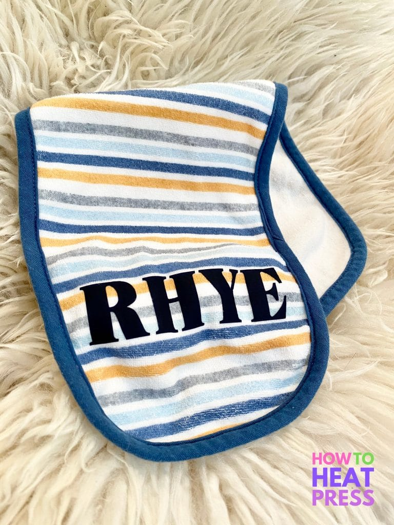 blue, white, and orange striped burp cloth with baby's name