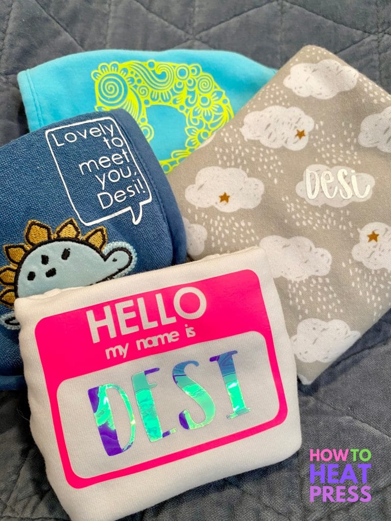 cricut baby onesie, bib, burp cloth, and baby blanket personalized with htv