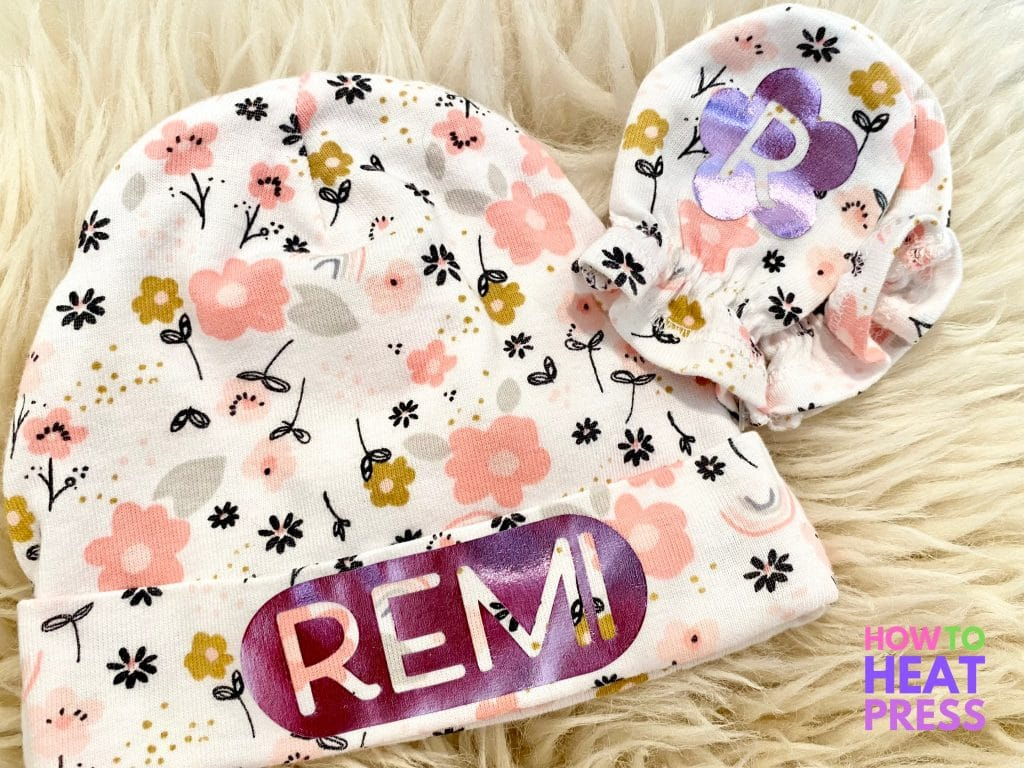 floral baby hat and mittens customized with purple metallic htv of baby name and initials