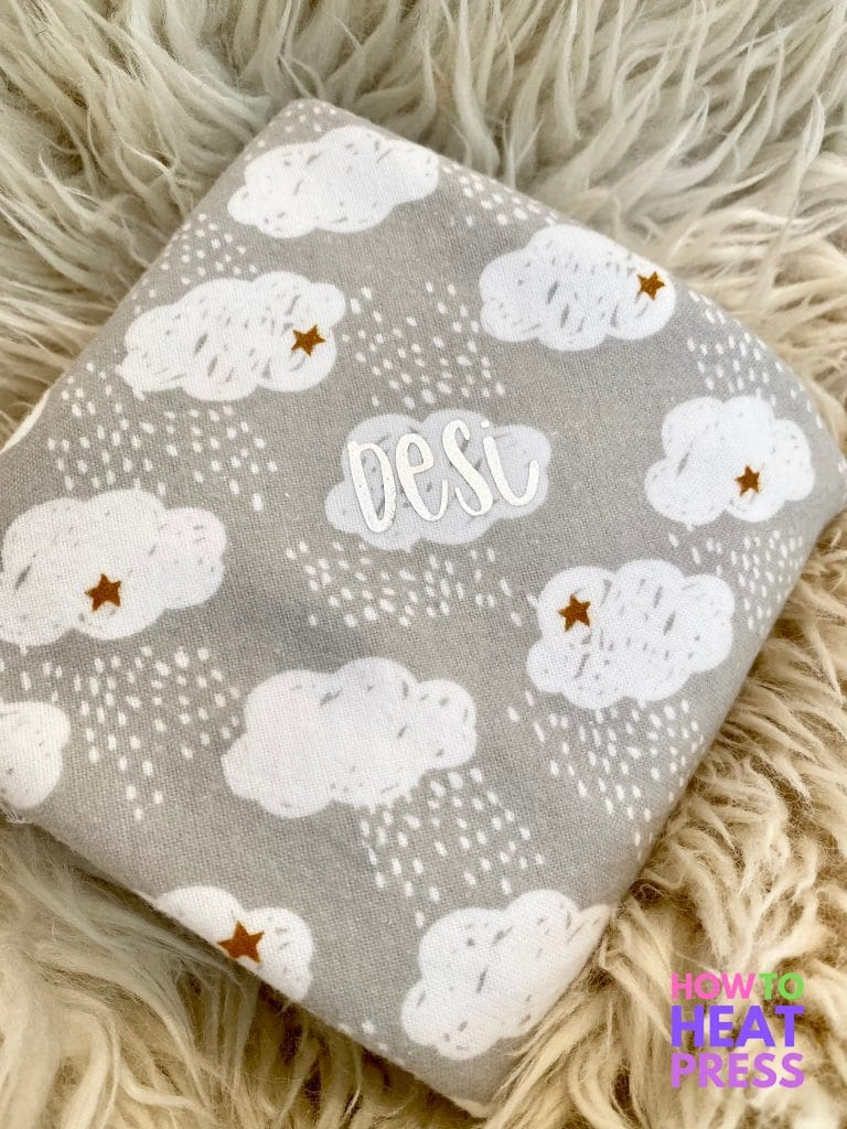 gray baby blanket with white clouds and baby's name in silver