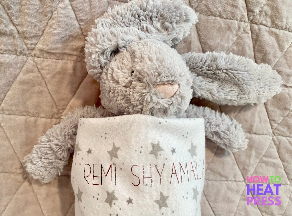 gray bunny in swaddle blanket with stars and pink baby name.JPG