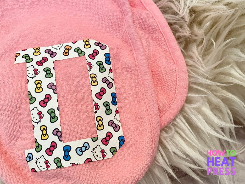 pink burp cloth with letter 'd' in hello kitty and bows htv