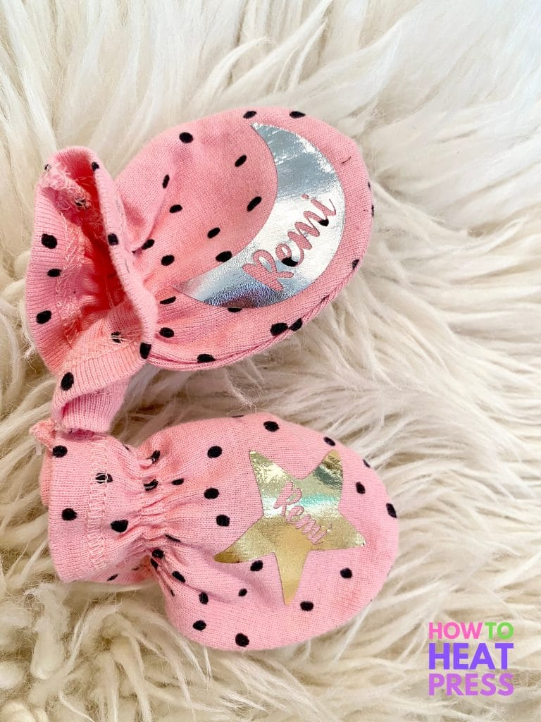 pink mittens with black polka dots and baby's name in moon and star metallic htv