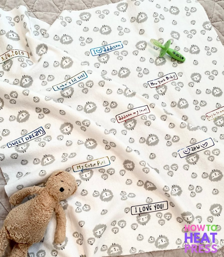 white baby blanket personalized with holographic htv