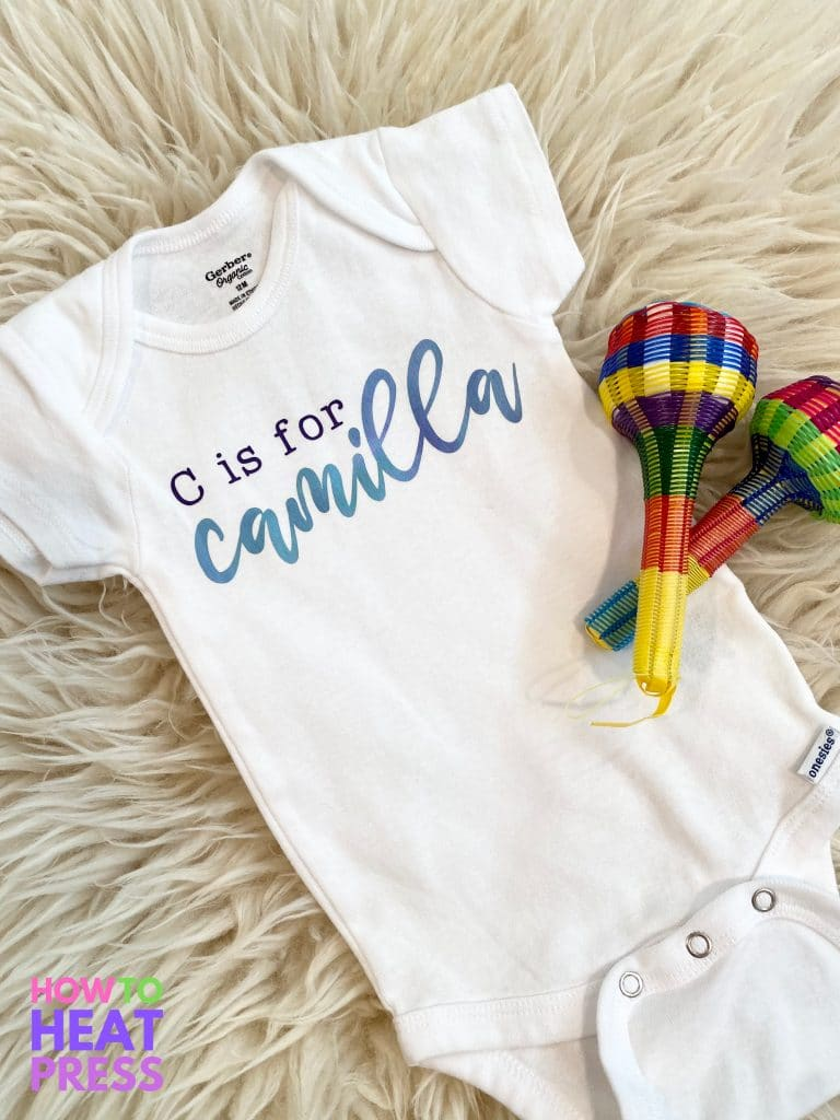 white onesie with watercolor blue cursive baby name