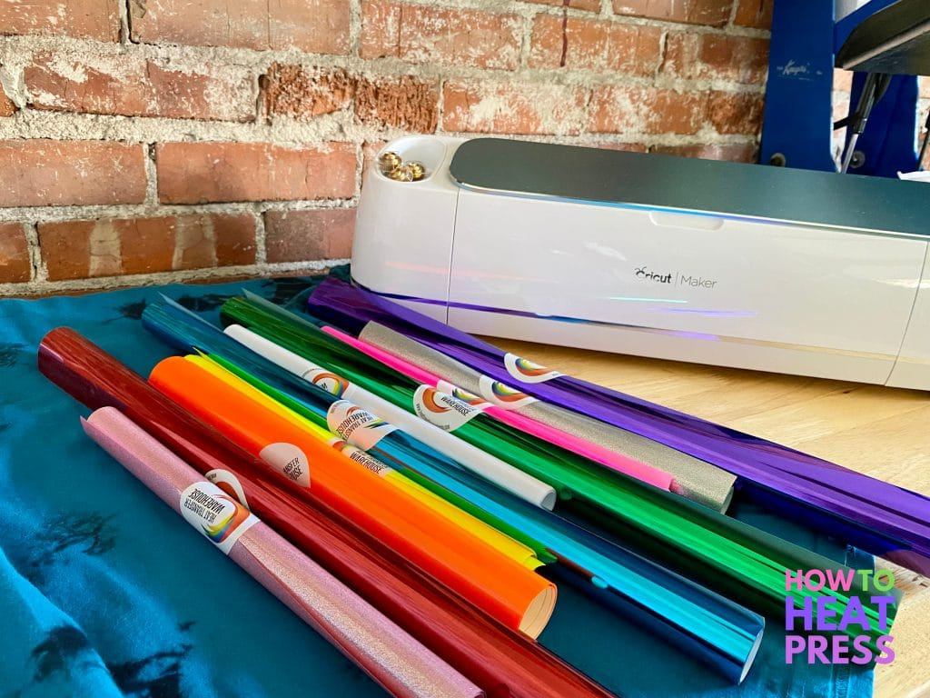 many colors of heat transfer vinyl with cricut maker and heat press for layering htv