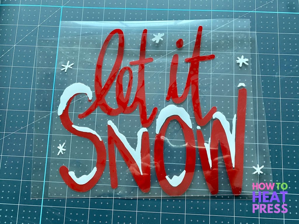 red and white 'let it snow' design for HTV on wood project