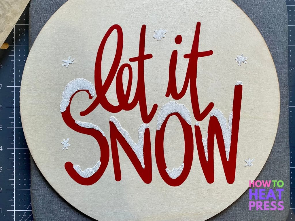 red letters with white snow in HTV on wood 'let it snow' sign